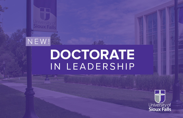 New! Doctorate in Leadership type over green outdoor space image