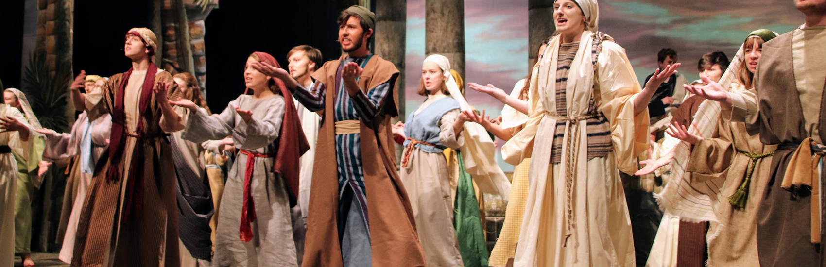 students dancing in theatre production