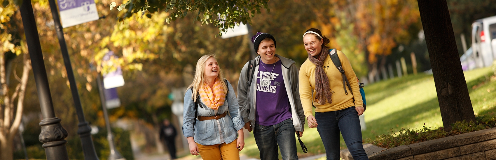 USF students walking on campus in the fall.