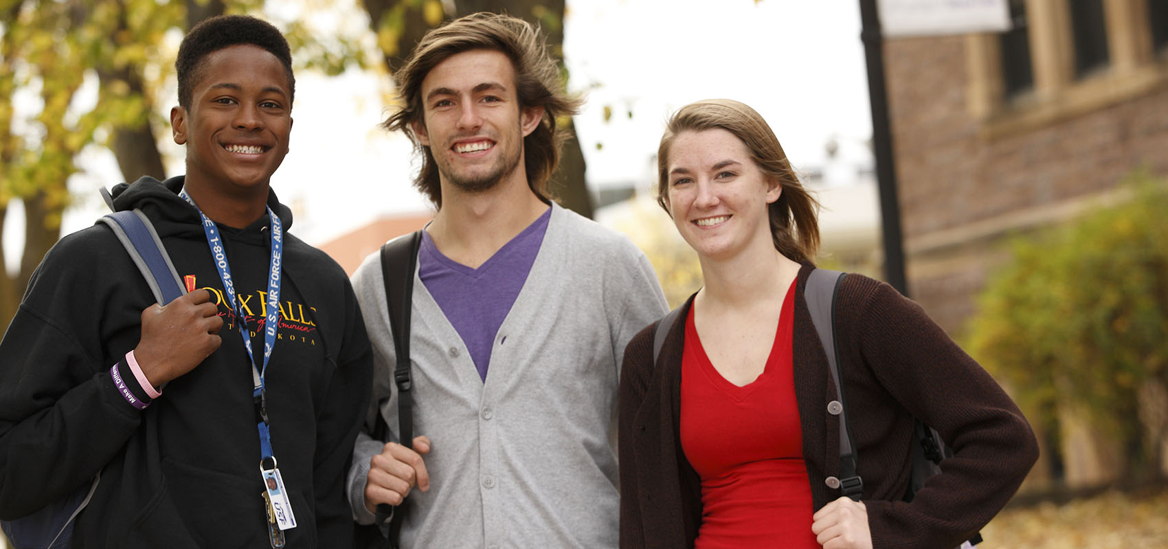 Three students in front of Jorden Hall on USF's campus.