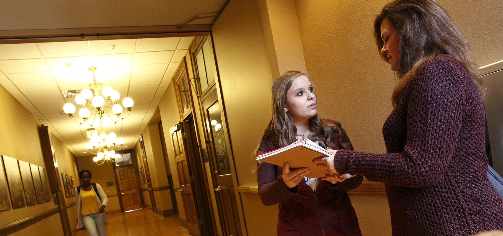 Professor Beth O'toole advising a student in Jorden Hall.