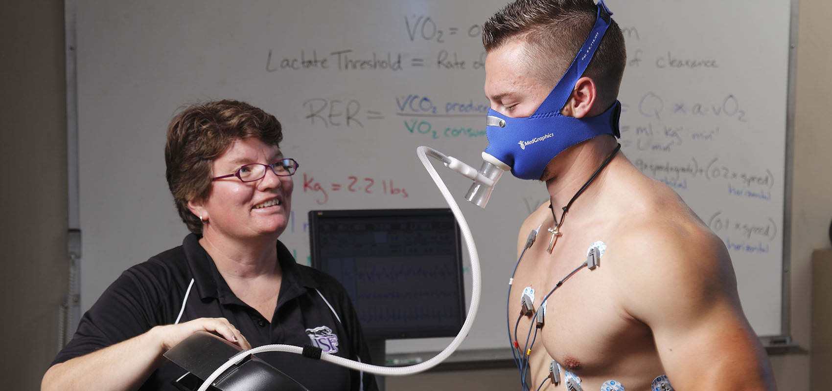 Professor Rebecca Schultz with student during Exercise Science class at USF.