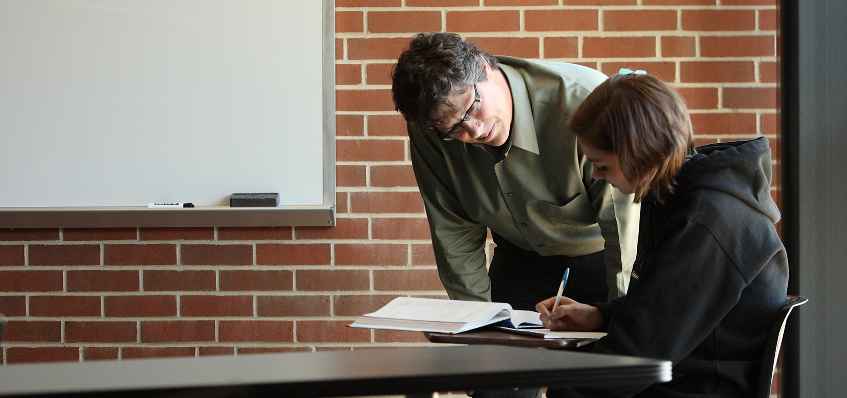 Professor Jason Douma working with a student.