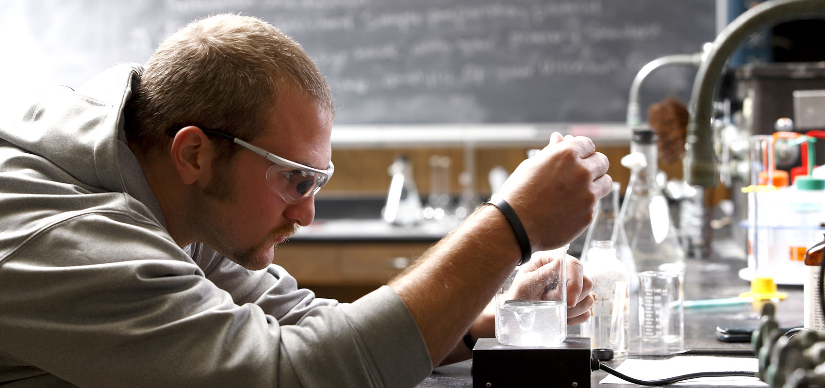 USF student conducting an experiment in the science lab.