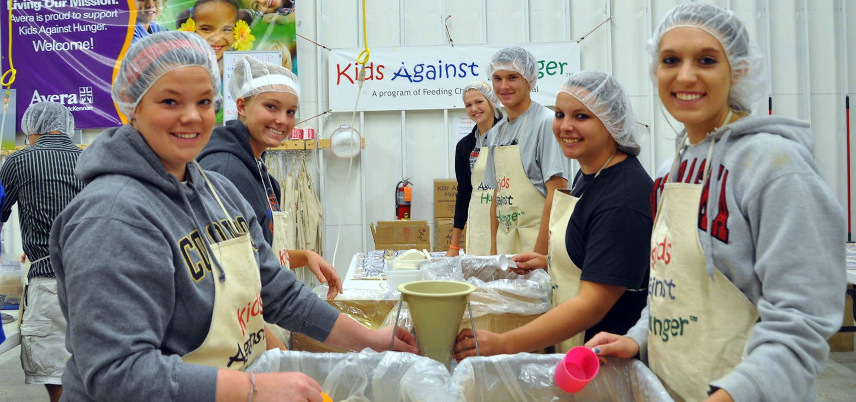 USF students serving at Kids Against Hunger.