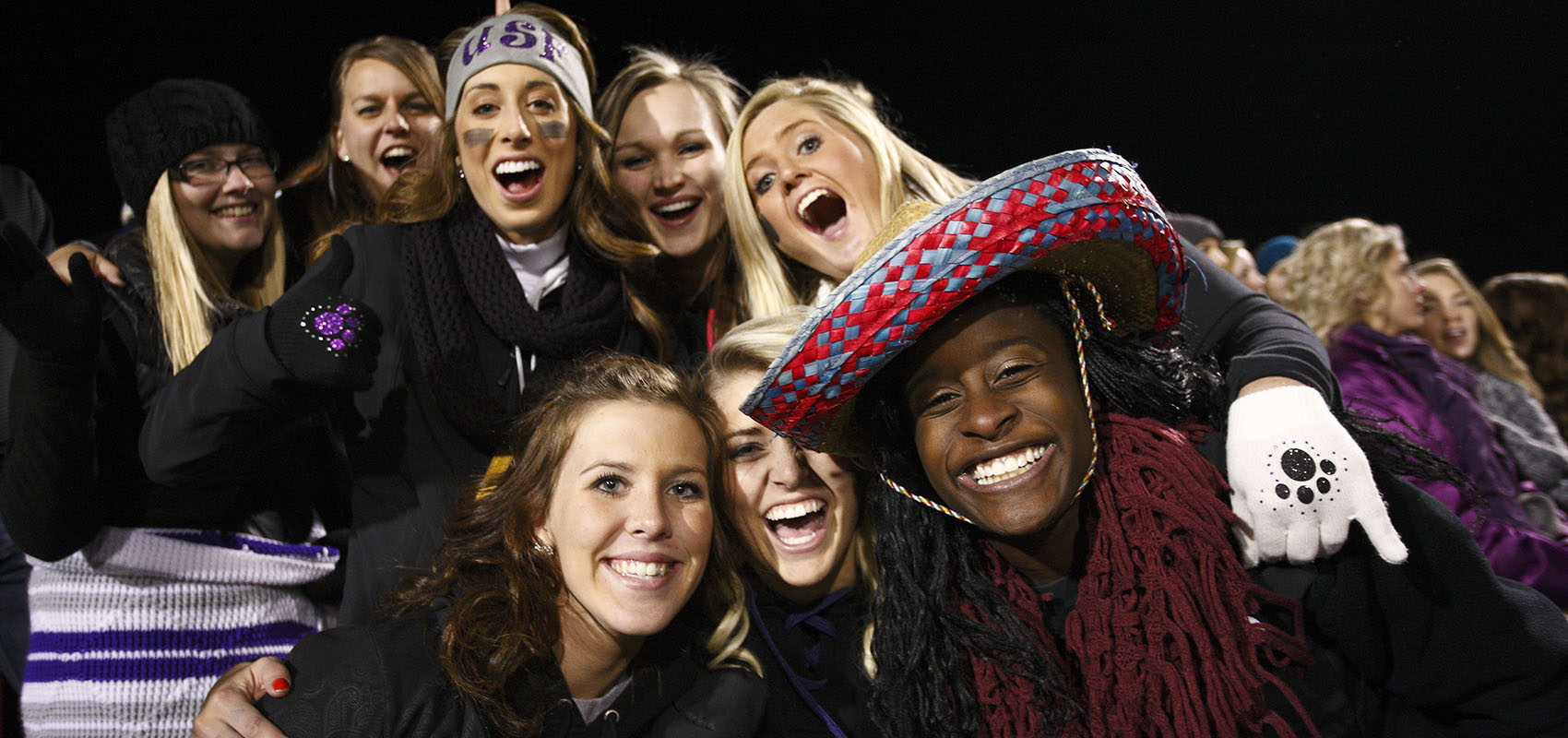 USF students cheering on the Cougars at a home football game.