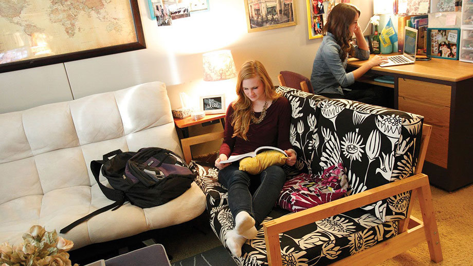 Female students studying in their dorm room.