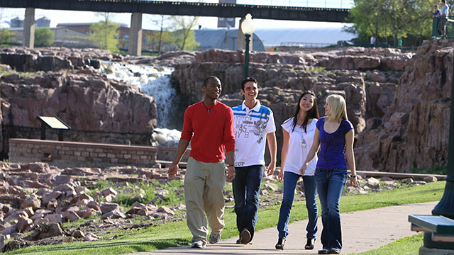 USF students walking through Falls Park in Sioux Falls.