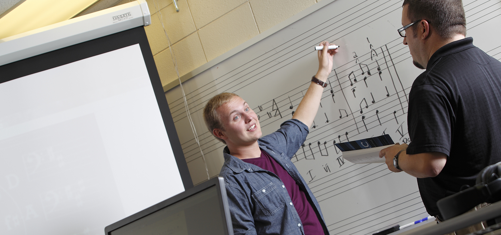 Dr. Jonathan Neiderhiser teaching a student during music theory class.